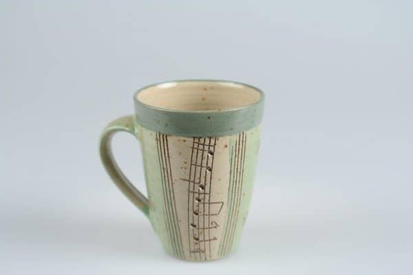 Töpferei Drehwurm Tasse Musik Noten grün