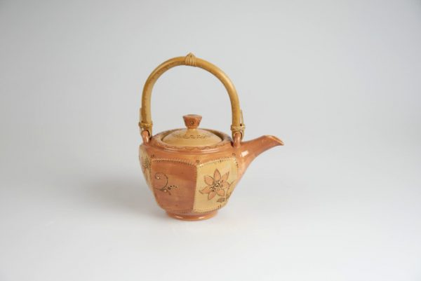 Töpferei Drehwurm Teekanne orange gold